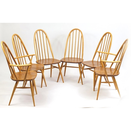 2017 - Ercol elm plank table and six stick back chairs including two carvers, 72cm H x 152cm W x 75cm D...