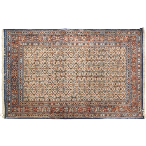 2003 - Rectangular Mahi design rug, 227cm x 147cm...