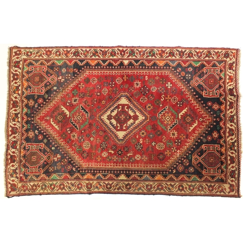 2010 - Rectangular Persian rug having an all over geometric motifs onto a predominantly red ground, 241cm x...