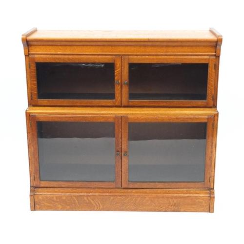 2022 - Oak two tier bookcase with glazed opening doors, 85cm H x 89cm W x 31.5cm D...