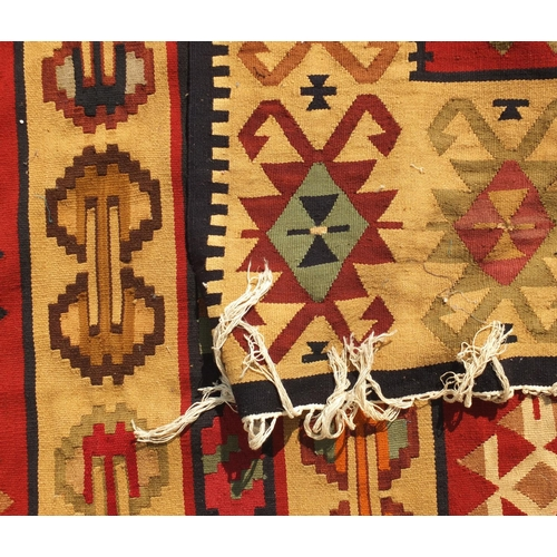2020 - Turkish Kilim rug, having an all over stylised design onto a predominantly beige ground, 225cm x 157...