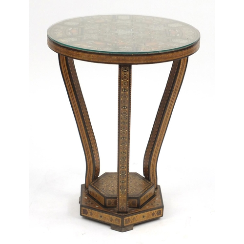 2025 - Moorish design circular topped occasional table, with hexagonal stepped base, having a geometric par...
