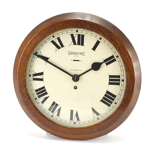 2035 - Oak cased Garnetric clock by John Garnett of London, 37cm in diameter...