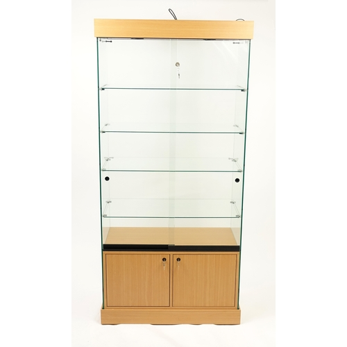 2027 - Modern light wood and glass display cabinet, 191cm H x 90.5cm W x 46.5cm D...