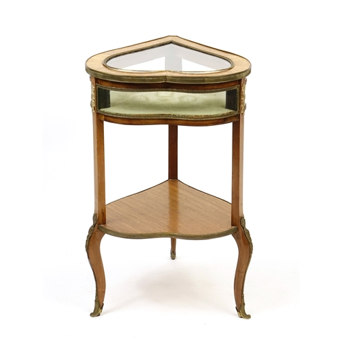 2007 - French rosewood bijouterie table, with heart shaped hinged lid with undertier and metal mounts, on c...