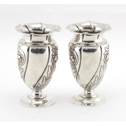 616 - Pair of Art Nouveau silver pedestal vases, embossed with stylised flowers, by Gibson & Co Ltd London...