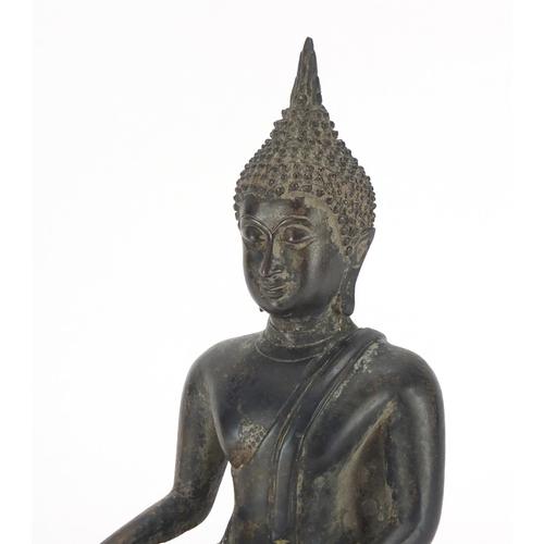 463A - Thai patinated bronze figure of seated Buddha, 24cm high...