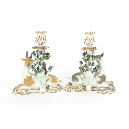 499 - Pair of 19th century hand painted porcelain candlesticks, modelled with goats, anchor marks to the r...