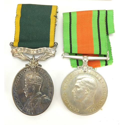 220 - British Military World War II medal group relating to SJT W Pearl, Territorial Efficient Service med...
