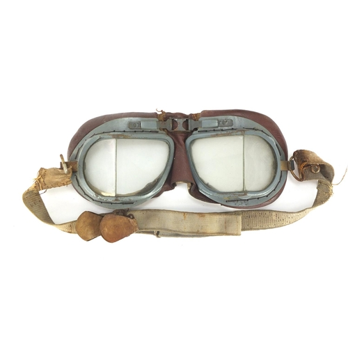 92 - AA Telegram Fanum car radiator badge and a pair of driving goggles, the badge numbered 46501, 14cm h...