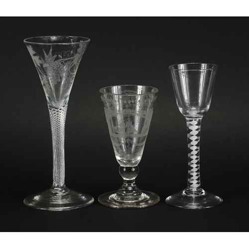 510 - Three antique glasses, two with air twist stems and one etched with a rigged ship under a bridge, th...