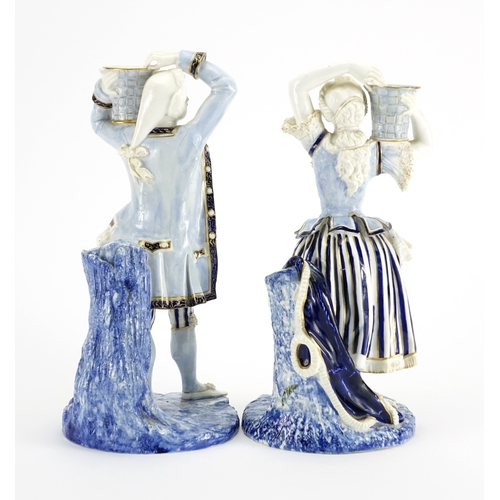 505 - Pair of 19th century Royal Worcester hand painted porcelain figural candlesticks, modelled as male a...