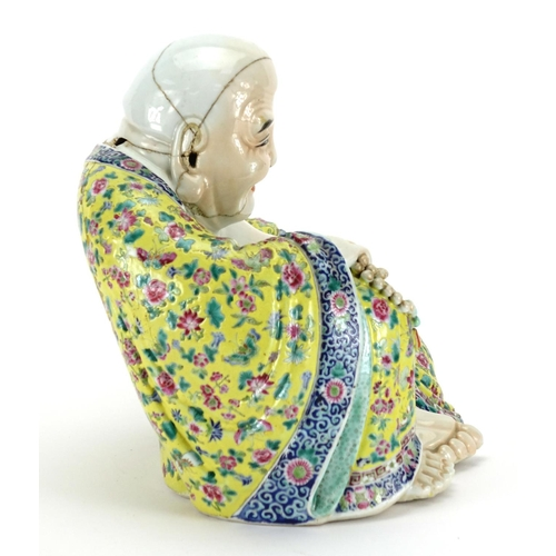 273 - Chinese porcelain figure of seated Buddha wearing a robe, finely hand painted with famille rose pale...