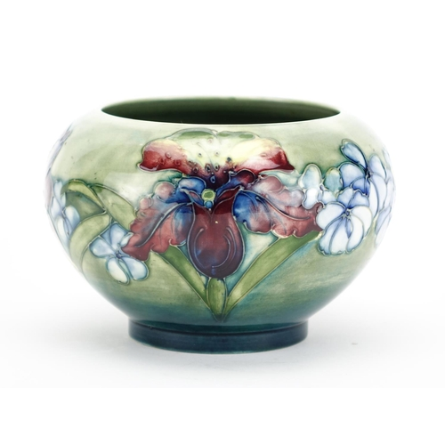 538 - Moorcroft pottery footed bowl, hand  painted and tube lined in the Orchid pattern, impressed and pai...