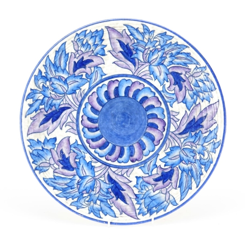 547 - Crown Ducal pottery wall plaque by Charlotte Rhead, hand painted and tube lined with stylised flower...