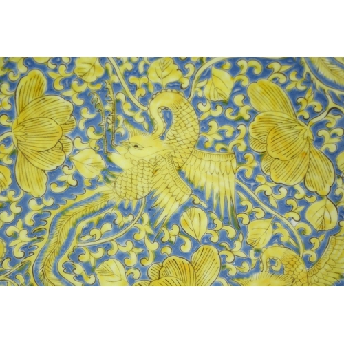 294 - Chinese porcelain shallow dish, hand painted in yellow with six phoenixes amongst flowers onto a blu...