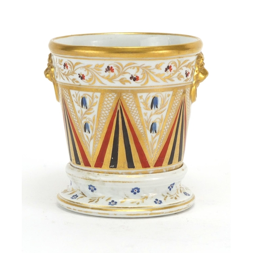 496 - 19th century porcelain Cache pot on stand with ring turned lions head handles, hand painted and gild...