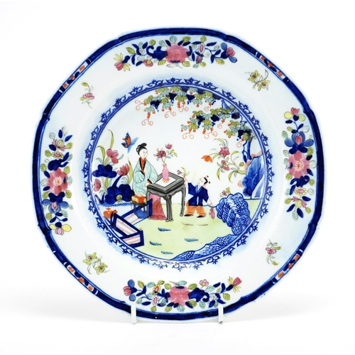 490 - 18th century porcelain soup bowl hand painted in the Chinese manner with figures and flowers, 23cm i...