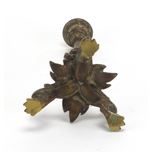 16 - 19th century patinated bronze candlestick with paw feet, the column decorated in relief with a lizar...