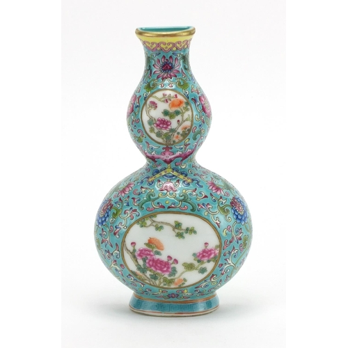 305 - Chinese porcelain double gourd vase wall pocket, finely hand painted in the famille rose with a bat ...