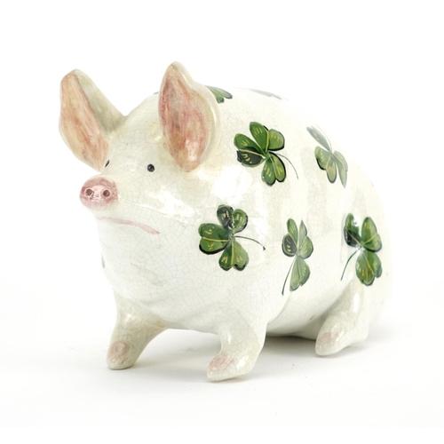 502 - Wemyss Ware pottery pig hand painted with shamrocks, impressed Wemyss Ware RH&S to the base, 10cm hi...