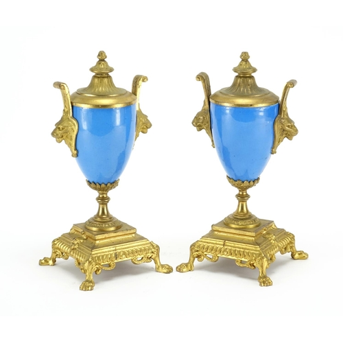 489 - Pair of 19th century Sevres style vase garnitures with twin lions head handles, each hand painted wi...