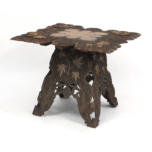 2035 - Anglo Indian hardwood folding table, profusely carved with fruiting leaves, 62cm H x 72cm W x 72cm D...