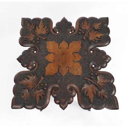 2039 - Anglo Indian folding table profusely carved with fruiting leaves, 62cm H x 60cm W x 60cm D...
