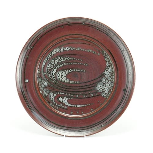 551 - Studio pottery charger by David Lloyd Jones, impressed marks to the underside, 47cm in diameter...