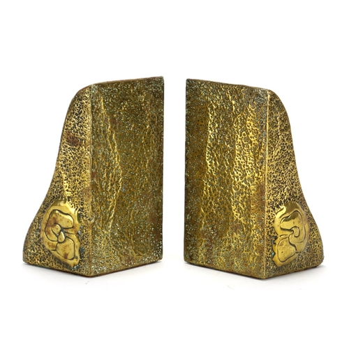 585 - Pair of Scottish school Arts & Crafts brass bookends, each embossed with stylised a bird, each 15.5c...