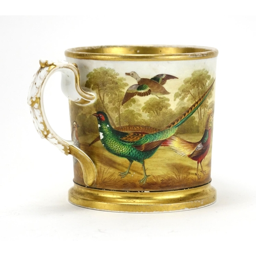 500 - 19th century porcelain tankard finely hand painted with wild birds before a landscape, 13.5cm high...