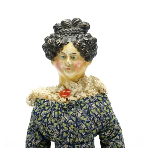131 - Early 19th century German Papier-mâché doll with wooden limbs in traditional dress, with Antiques Ro...