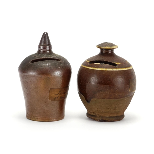 509 - Two 19th century salt glazed pottery money boxes, the largest 13cm high...