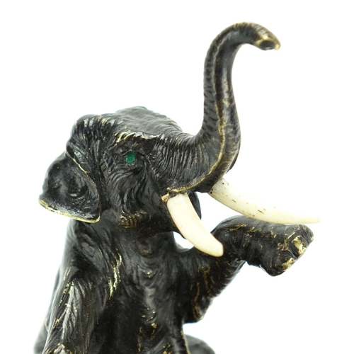 11 - Japanese patinated bronze elephant and serpentine marble pin dish, 15.5cm high...