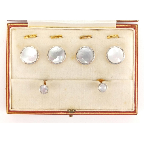683 - Set of 18ct gold, platinum and Mother of Pearl buttons and studs, housed in a Goldsmith's & Silversm...