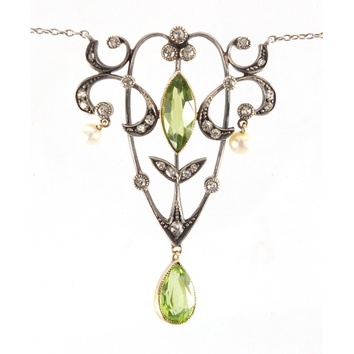 669 - Art Nouveau unmarked gold diamond, peridot and seed pearl necklace, housed in a Stewart Dawson & Com...