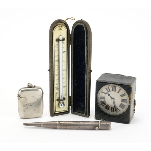 42 - Miscellaneous objects comprising a silver vesta, Parker's pointer pencil, leather cased travel clock...