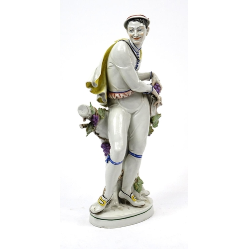 483 - Large 19th century continental hand painted porcelain figure of a grape picker, incised HM27 and fac...