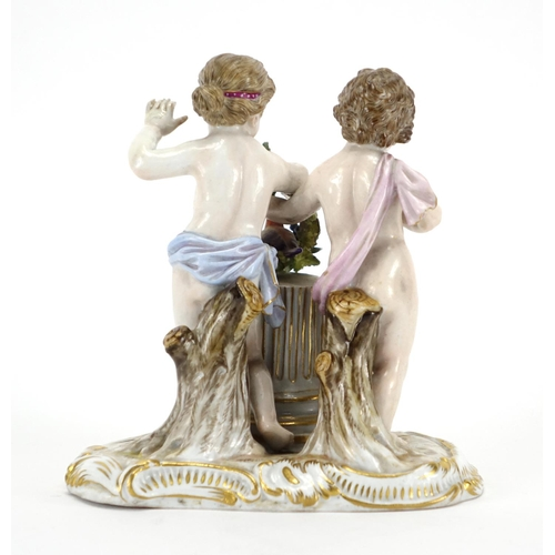 484 - 19th century Meissen hand painted porcelain figure group of two putti holding a wreath with a bird, ...