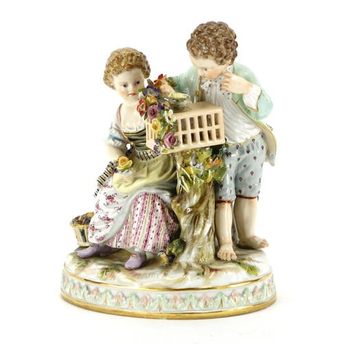 486 - 19th century Meissen porcelain figure group of two children nesting a chick, blue cross sword marks ...