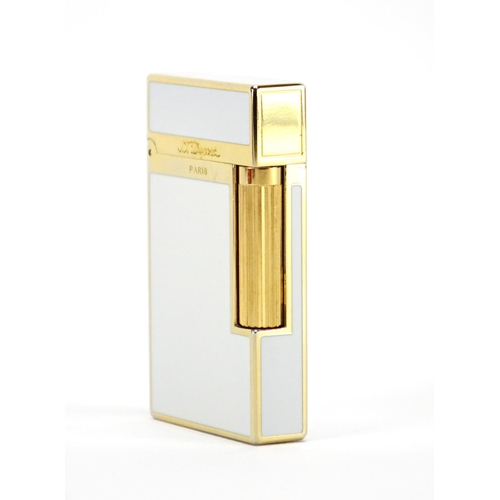 52 - S. T. Dupont gold plated and white enamelled pocket lighter with fitted case and box, serial number ...