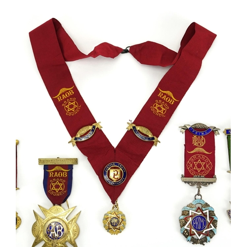 187 - Four Royal Order of Buffalos jewels and a sash including three silver and enamel presented to C Croc...