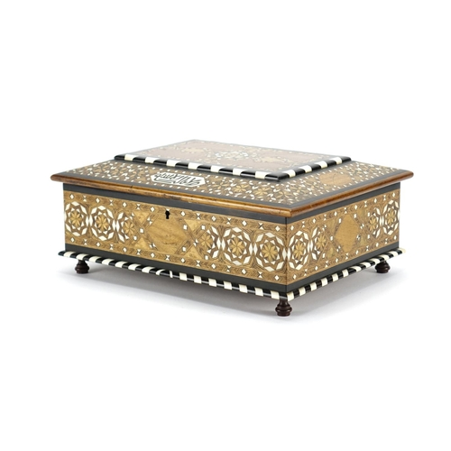 479 - Islamic Moorish style inlaid wooden casket with geometric inlay and script, the hinged lid opening t...