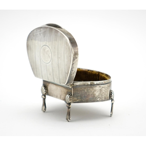 641 - Silver four footed jewel box, the hinged lid with engine turned decoration, I J C Birmingham 1919, 7...