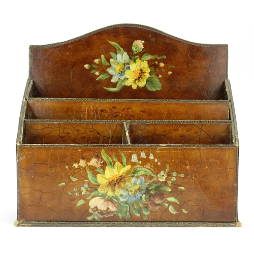 23 - Three piece leather desk set comprising a letter rack, inkwell and blotter, each hand painted with f...