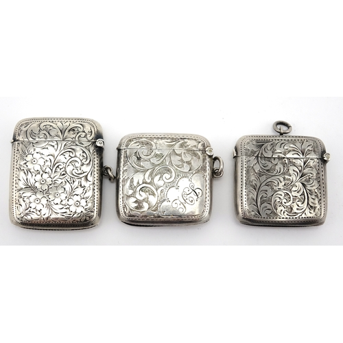 644 - Three rectangular silver vesta's with engraved floral decoration, Birmingham hallmarks, the largest ...