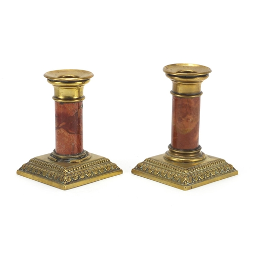 17 - Pair of brass candlesticks with cylindrical marble columns, 12cm high...