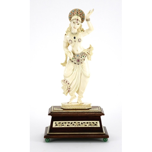460 - ** DESCRIPTION AMENDED 10/1 ** Anglo-Indian carved ivory jewelled Goddess, raised on a carved rectan...