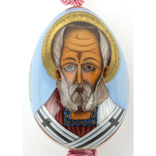 5 - Russian porcelain egg, hand painted with the priest Nikona, 10.5cm high...