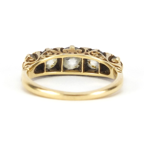 666 - 18ct gold diamond five stone ring, housed in an A J Davis & Co Plaistow tooled leather box, size M, ...
